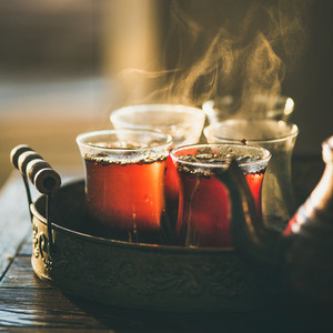 Freshly brewed black tea in turkish glasses  square crop