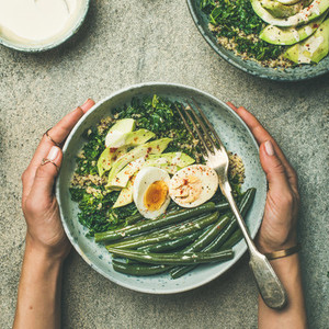 Quinoa  kale  green beans  avocado  egg bowls flat lay  square crop