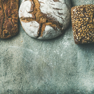 Top view of bread loaves over grey background square crop