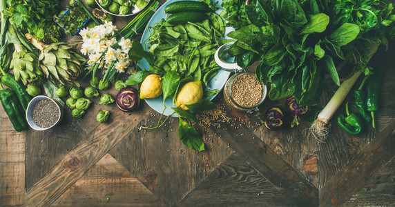 Spring healthy vegan food cooking ingredients wooden background wide composition