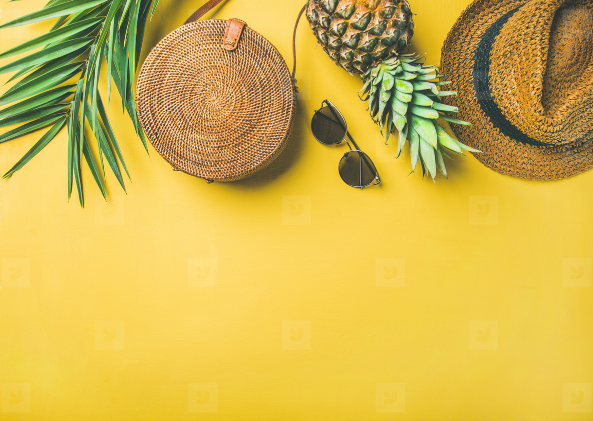 Colorful summer female fashion outfit over yellow background