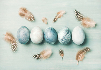 Painted traditional eggs for Easter holiday with feathers  horizontal composition