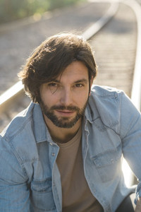 Portrait of bearded adult man in sunlight