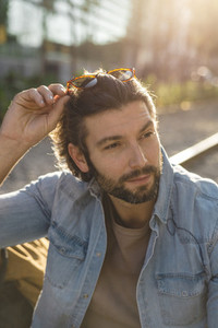 Portrait of bearded adult man in sunlight