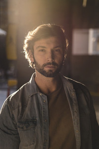 Handsome brutal bearded man in sunlight