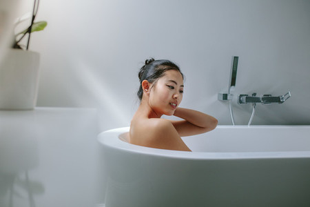 Young asian woman in bathtub