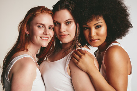 Women of different size in white tank top