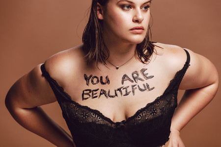 Plus size woman in black lingerie