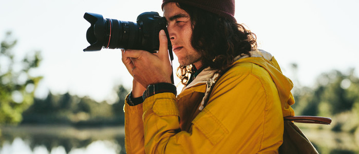 Close up of a traveler taking photo of nature