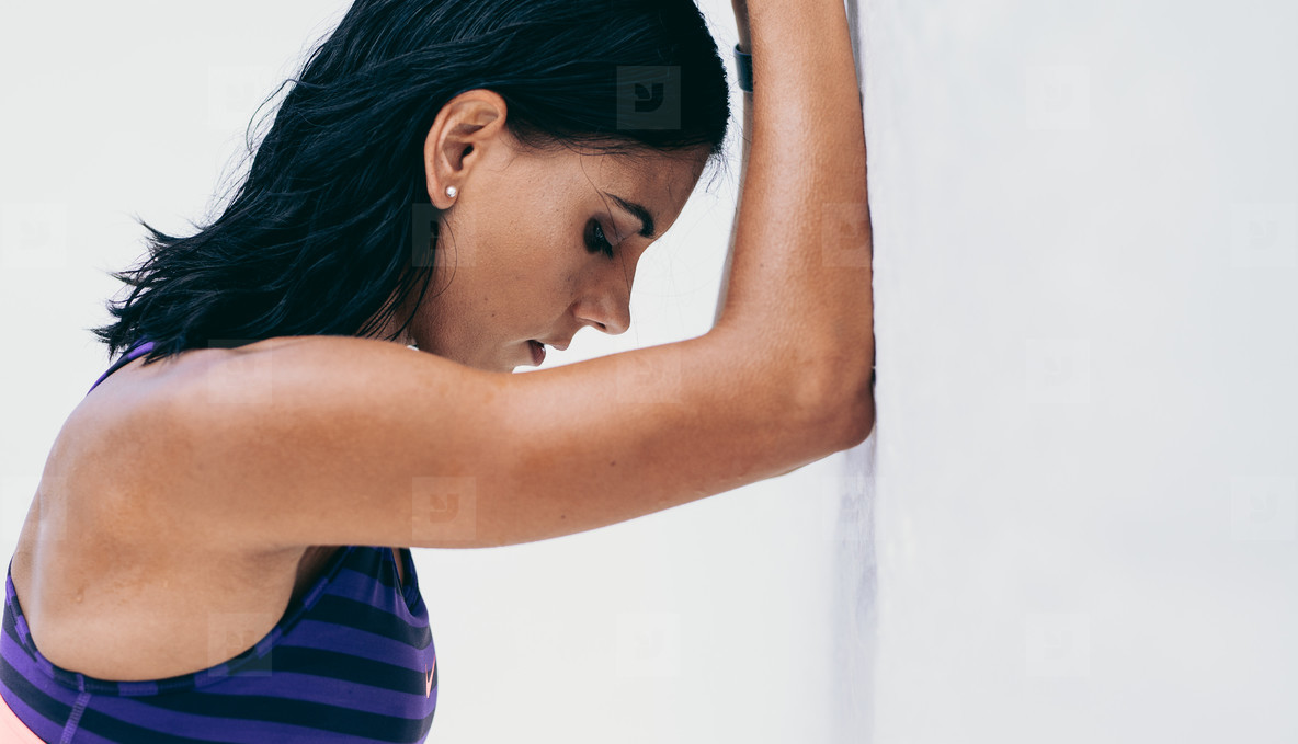 Close up of a female athlete standing close to a wall