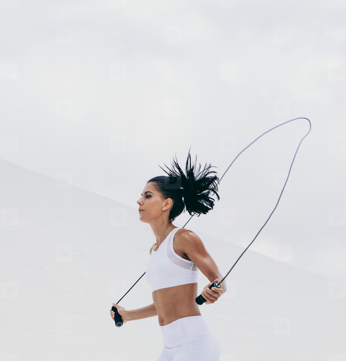Fitness woman doing workout using a skipping rope