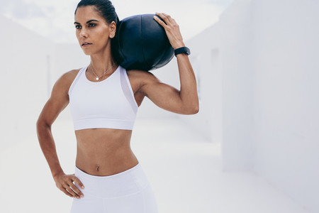 Fitness woman training with a medicine ball