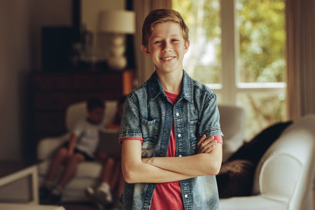 Smiling boy standing at home