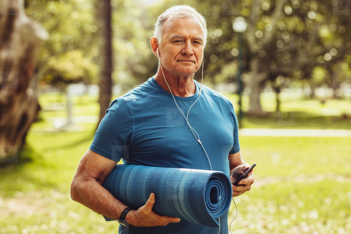 Senior fitness person walking in park