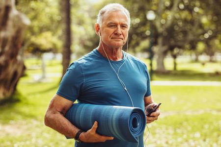 Senior fitness person walking in park