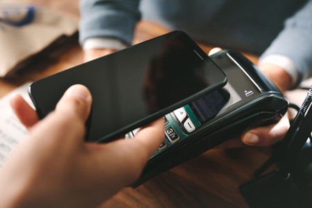 Customer paying through smartphone using NFC technology