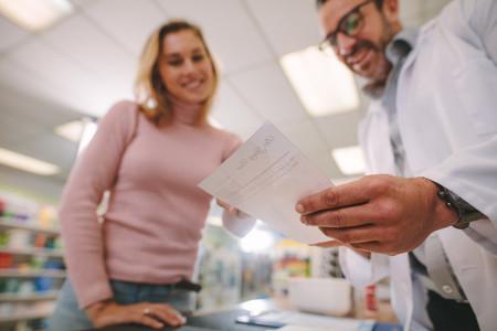 Chemist explaining a prescription to customer