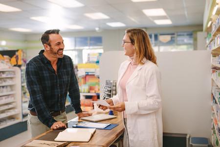 Pharmacist helping customer at pharmacy