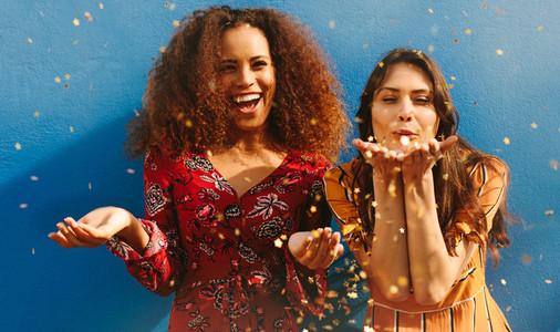 Women friends having fun with glitters
