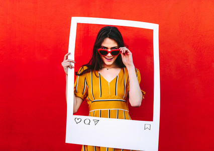 Woman posing with social network post photo frame