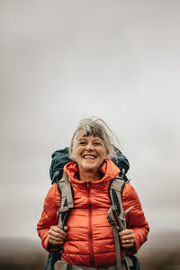Close up of a smiling female hiker standing outdoors