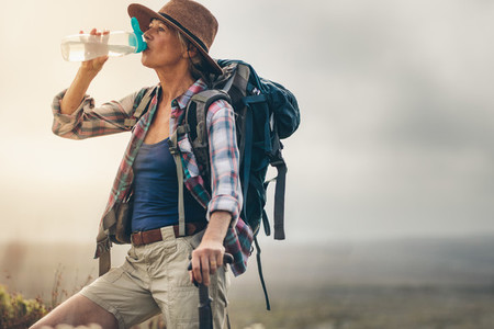 Portrait of a female hiker drinking water