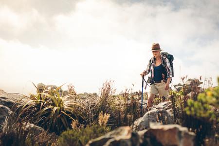 Woman trekking down a hill