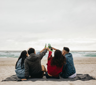 Group of friends having party on beach
