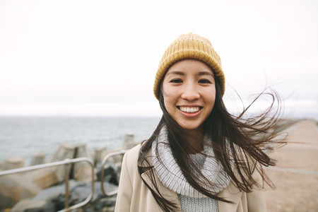 Portrait of a smiling asian woman in winter clothes