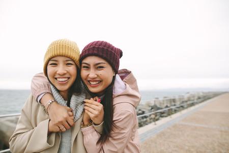 Two asian women having fun outdoors