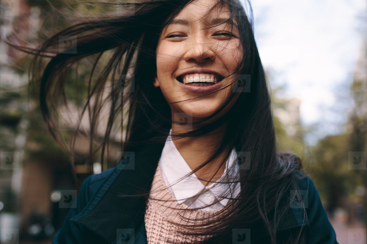 Close up of a smiling asian woman