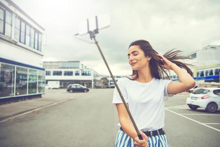 Gorgeous woman taking a self portrait