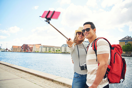 Happy young tourists posing for a selfie