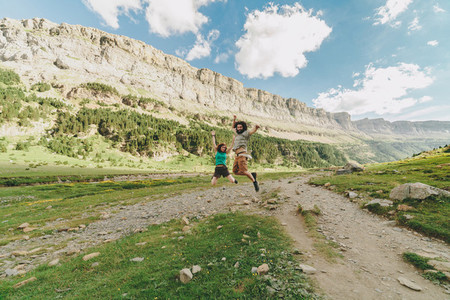 Young couple jumping in a big valley of soaso