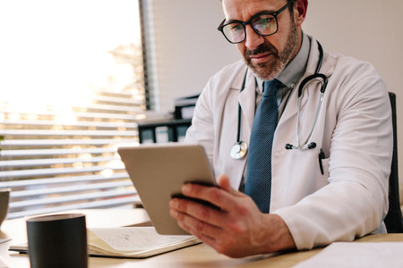 Doctor making use of technology in his diagnosis
