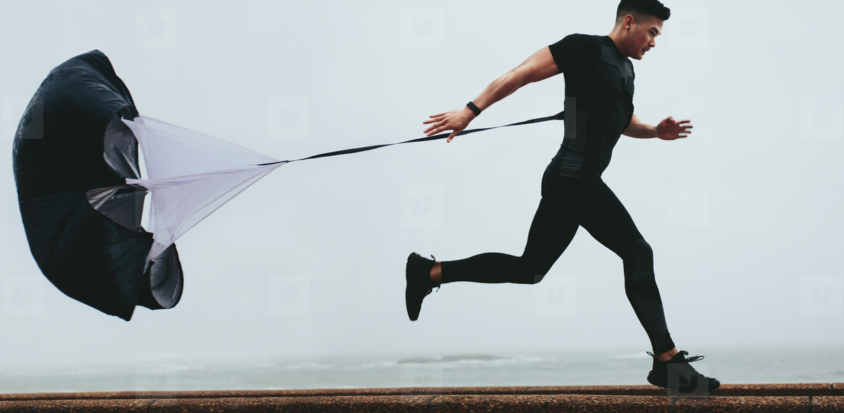 Runner working out using resistance parachute