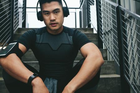 Asian man relaxing after workout