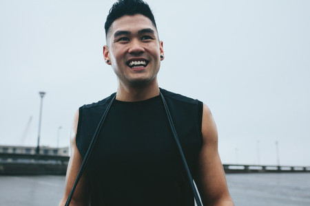 Asian man ready for fitness training outdoors