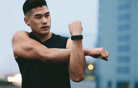 Asian fitness man doing warmup workout