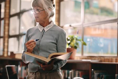 Senior female professor teaching in classroom