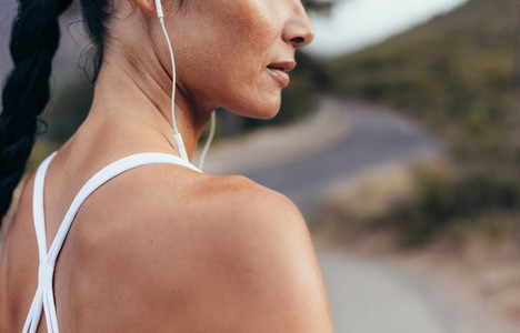 Woman listening to music during workout