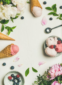 Flat lay of ice cream scoops and peonies  vertical composition