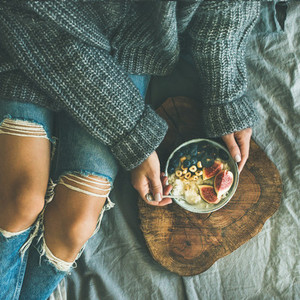 Healthy vegetarian winter breakfast in bed concept top view