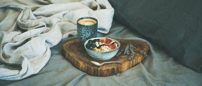 Rice coconut porridge and espresso in bed  wide composition