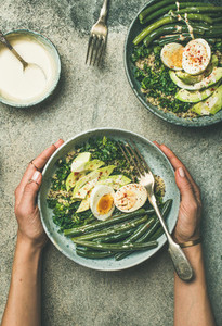 Quinoa  kale  green beans  avocado  egg bowls flat lay  vertical composition