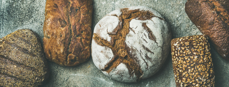 Top view of bread loaves over grey background