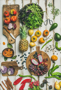 Helathy vegan food cooking background with raw fruites and vegetables