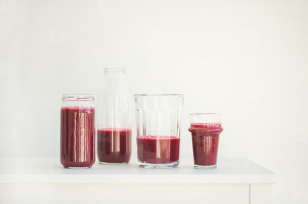 Fresh morning beetroot smoothie or juice in glasses  copy space