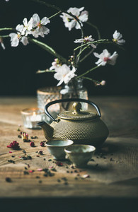 Traditional Asian tea ceremony arrangement over wooden background