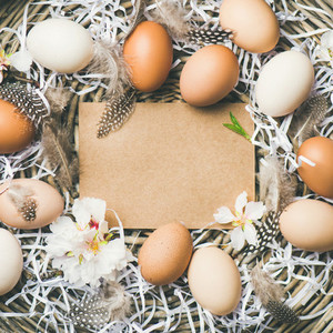 Natural colored eggs for Easter in basket  square crop